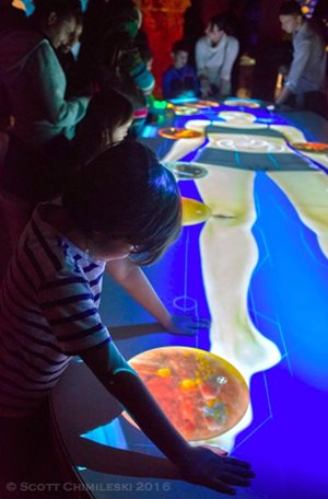 The interactive human microbiome exhibit intrigues children at The Secret World Inside You. Photo credit: Scott Chimileski