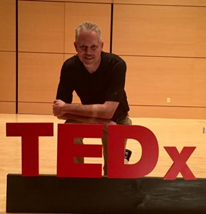 Rodney Rohde with TEDx sign.